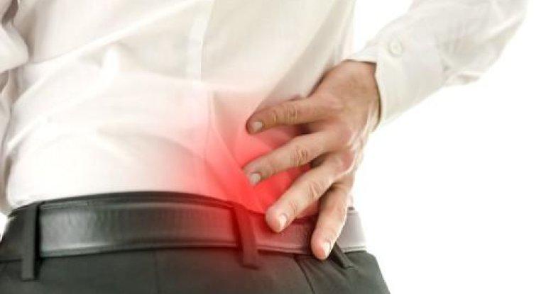 Почему болит спина в области крестца?