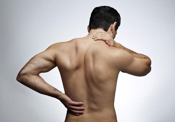 Возникновение боли в области хребта