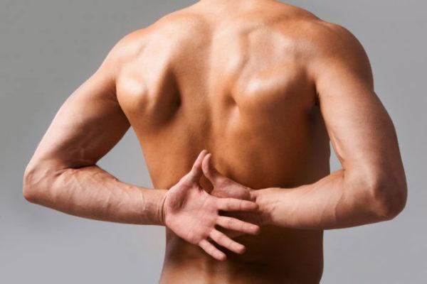 Боль в спине слева от позвоночника